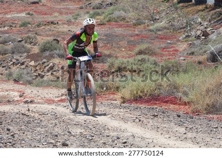 "LANZAROTE, SPAIN - MAY 03: Antonio Lazaro N184 in action at Adventure mountain bike marathon ""Ultrabike Santa Rosa"" May 03, 2015. Lanzarote, Canaries islands, Spain. - stock photo"
