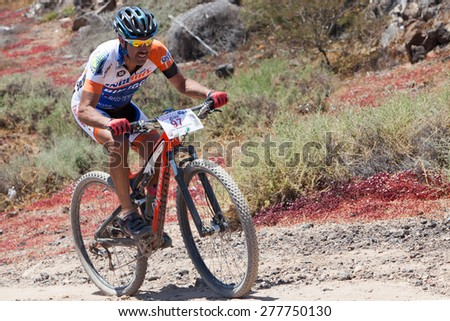"LANZAROTE, SPAIN - MAY 03: Juan Francisco Gil N97in action at Adventure mountain bike marathon ""Ultrabike Santa Rosa"" May 03, 2015. Lanzarote, Canaries islands, Spain. - stock photo"