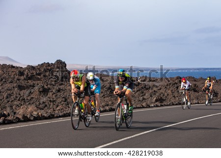 LANZAROTE, SPAIN- MAY 21:Sportsman Jose Fernandez (1105 ESP) leads  a group of rides   during the IRONMAN LANZAROTE triathlon on May 21, 2016 in Tamanfaya, Lanzarote, Las Palmas, Canary Islands, Spain - stock photo