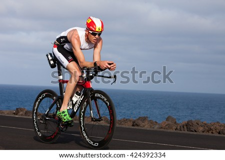 LANZAROTE, SPAIN - MAY 21: Sportsman Nicholas Ward Mu�±oz (9 GBR) rides a bike during the IRONMAN LANZAROTE triathlon on May 21, 2016 in Tamanfaya, Lanzarote, Las Palmas, Canary Islands, Spain