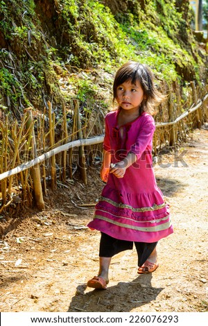 LAO CHAI VILLAGE, VIETNAM - SEP 22, 2014: Unidentified Hmong little girl in a village Lao Chai in Vietnam. Hmong is on of the minority eethnic group in Vietnam