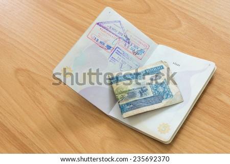 Lao PDR passport stamp with Kip money - stock photo