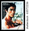 LAOS - CIRCA 1999: A postage stamp printed in Laos showing Bruce Lee, circa 1999 - stock photo