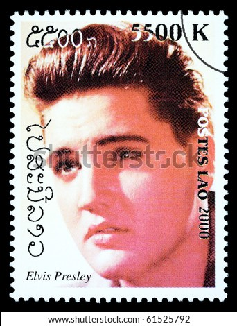 LAOS - CIRCA 1999: A postage stamp printed in Laos showing Elvis Presley, circa 1999 - stock photo