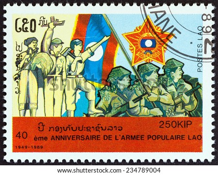 "LAOS - CIRCA 1989: A stamp printed in Laos from the ""40th anniversary of People's Army "" issue shows peasant, revolutionary, worker and soldiers, circa 1989. - stock photo"
