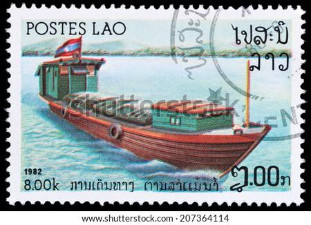 LAOS - CIRCA 1982: A stamp printed in Laos showing Houseboat, circa 1982 - stock photo