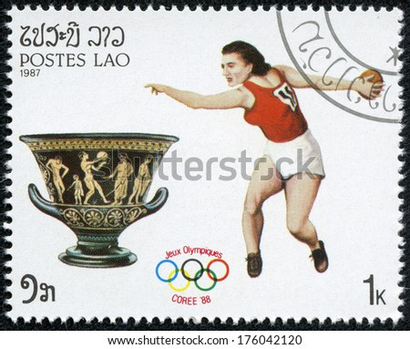 LAOS - CIRCA 1987: A stamp printed in Laos shows an athlethe javelin throwing, series Olympic Games in Seoul 1988, circa 1987
