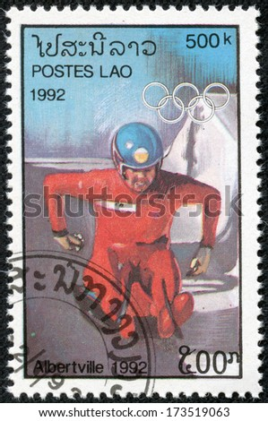 "LAOS - CIRCA 1989: stamp printed by Laos, shows Toboggan and Olympic Rings, with inscription ""Albertville, 1992"", from the series ""Winter Olympic Games, Albertville, 1992"", circa 1989."
