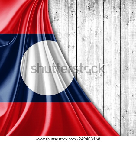 Laos flag and wood background