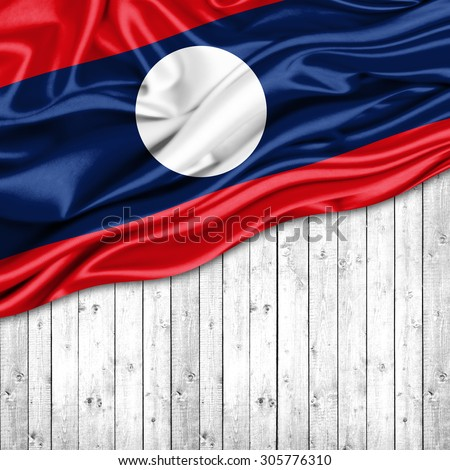 Laos   flag of silk with copyspace for your text or images and wood background