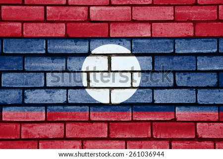 Laos flag painted on old brick wall texture background - stock photo