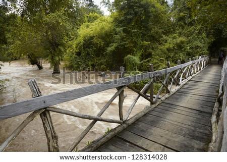 Laos. Siphandon. Wooden bridge over the Mekong river - stock photo