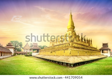 Laos travel landmark, golden pagoda wat Phra That Luang at sunset sky in Vientiane, Buddhist temple, Religious architecture and landmarks, Famous tourist destination in Asia. - stock photo