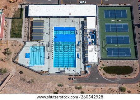 Lap pools and tennis courts from above - stock photo