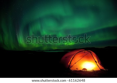 Laponia 2010 - Northernlights over the tent on the Padjelantaleden hiking trail at night in September 2010 - stock photo