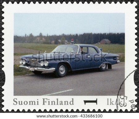 LAPPEENRANTA, FINLAND - AUGUST 12, 2013: A stamp printed in Finland shows Plymouth Fury, series Finland Official Vintage Police Car - stock photo