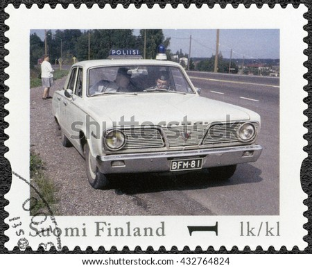 LAPPEENRANTA, FINLAND - AUGUST 12, 2013: A stamp printed in Finland shows Plymouth Valiant, series Finland Official Vintage Police Car - stock photo