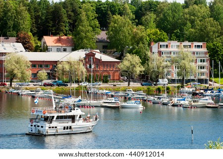LAPPEENRANTA, FINLAND - JUNE 15, 2016: People sail on the white boat to harbor on Saimaa Lake. View from Linnoitus Fortress