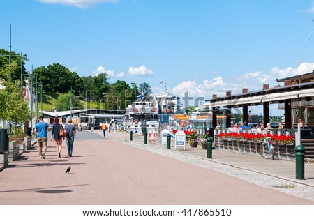 LAPPEENRANTA, FINLAND - JUNE 15, 2016: People walk along the floating restaurants on The Saimaa Lake embankment in summer