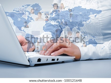Laptop and business person against technology background - stock photo