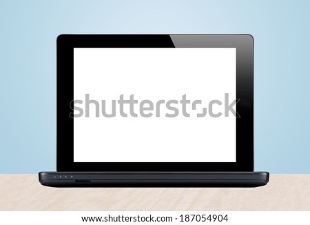Laptop and cactus in flowerpot on wooden table on grey background