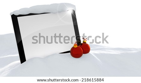 laptop and christmas balls in a snowdrift - stock photo