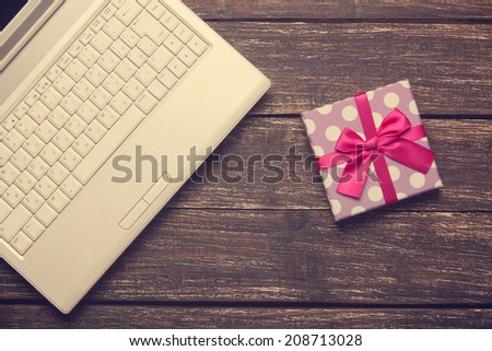 Laptop and christmas gifts - stock photo