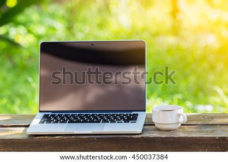 laptop and coffee,garden Vintage style background