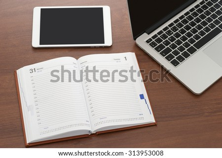 Laptop and digital tablet, notebook top view - stock photo