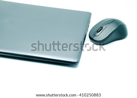 Laptop and mouse on white background.
