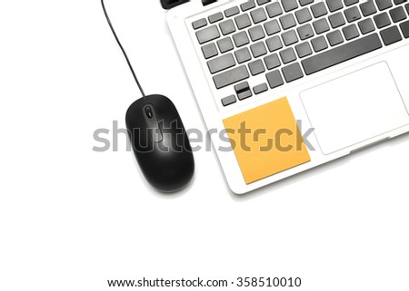 laptop and mouse with sticky note isolated on white background