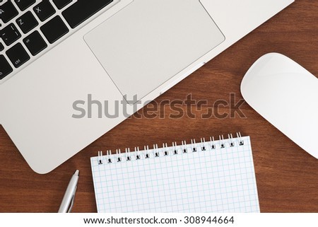 Laptop and notebook and mouse top view - stock photo