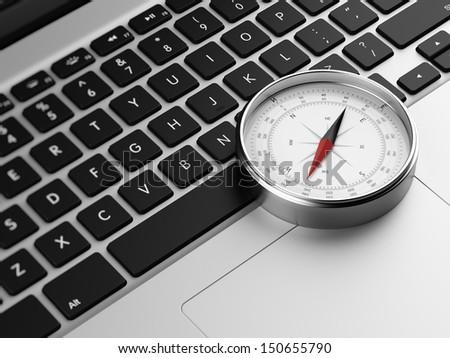 laptop and retro compass - stock photo