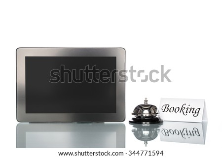 Laptop and Service bell on white background, booking - stock photo