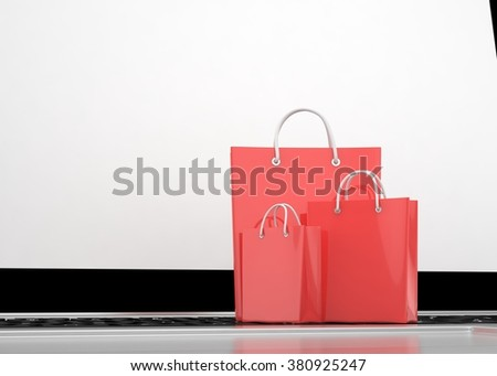 laptop and  shopping pags on white background