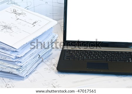 Laptop and stack of project drawings. Working place. White screen - stock photo
