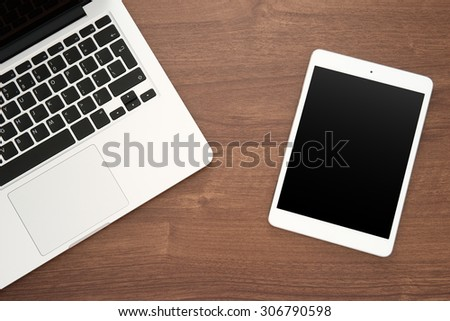Laptop and tablet computer top view - stock photo