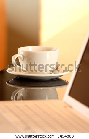 Laptop and tea cup - stock photo