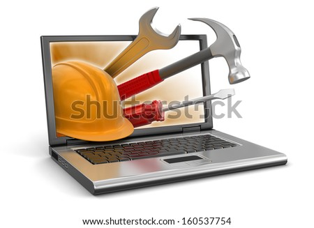Laptop and tools (clipping path included) - stock photo