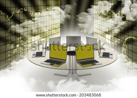 Laptop around the table - stock photo