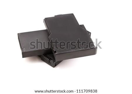 Laptop batteres stacked on white background - stock photo