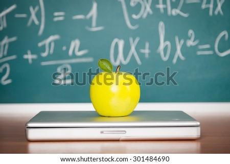 Laptop, classroom, blackboard. - stock photo