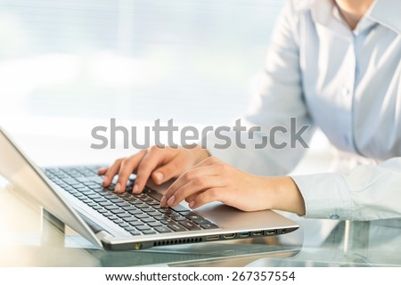 Laptop. Close-up shot of a female learner typing on the laptop keyboard - stock photo