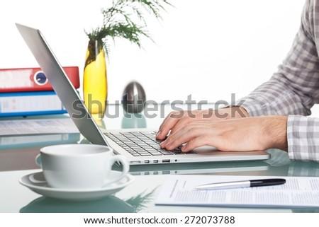 Laptop. Closeup of businessman typing on laptop computer - stock photo