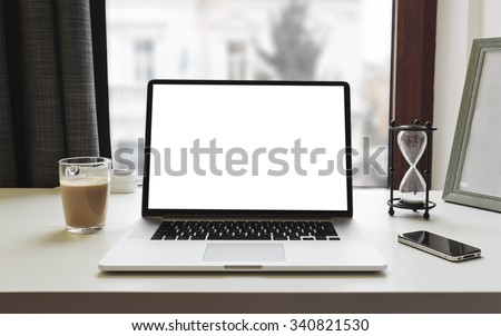 Laptop, coffee and phone  on workspace - stock photo