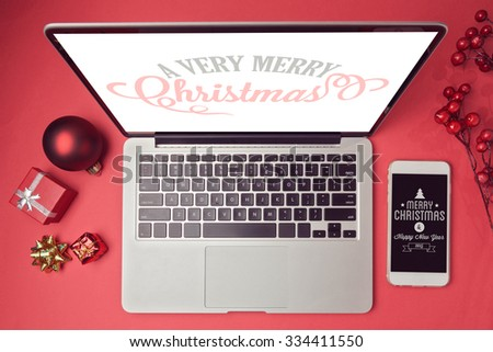 Laptop computer and smartphone with Christmas decorations. Christmas mock up template. View from above - stock photo