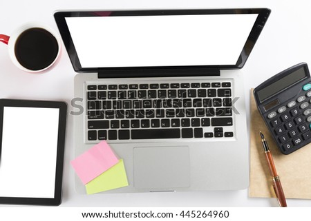 laptop computer, calculator and tablet on white background - top view