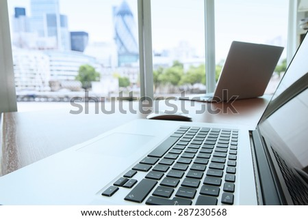 laptop computer is on wooden desk as workplace concept  - stock photo
