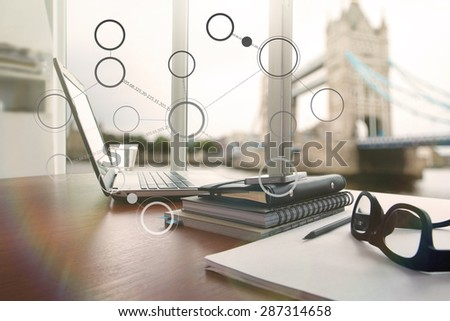 laptop computer is on wooden desk as workplace concept with overcast effect with social media diagram - stock photo