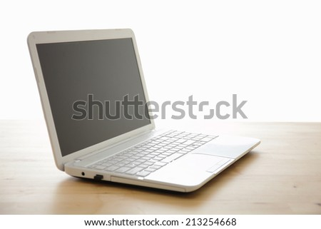 Laptop computer on a wooden desk. screen is great for your copy space - stock photo